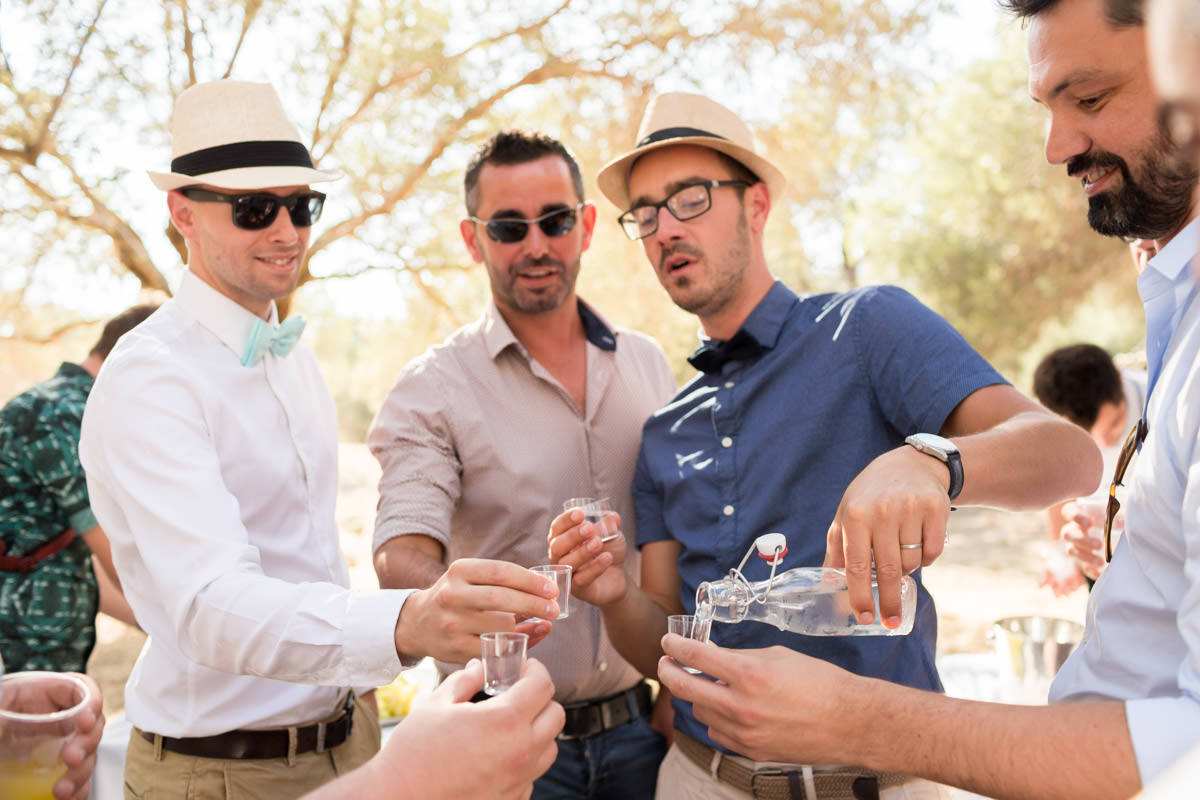 guests on a wedding in Crete drinking raki