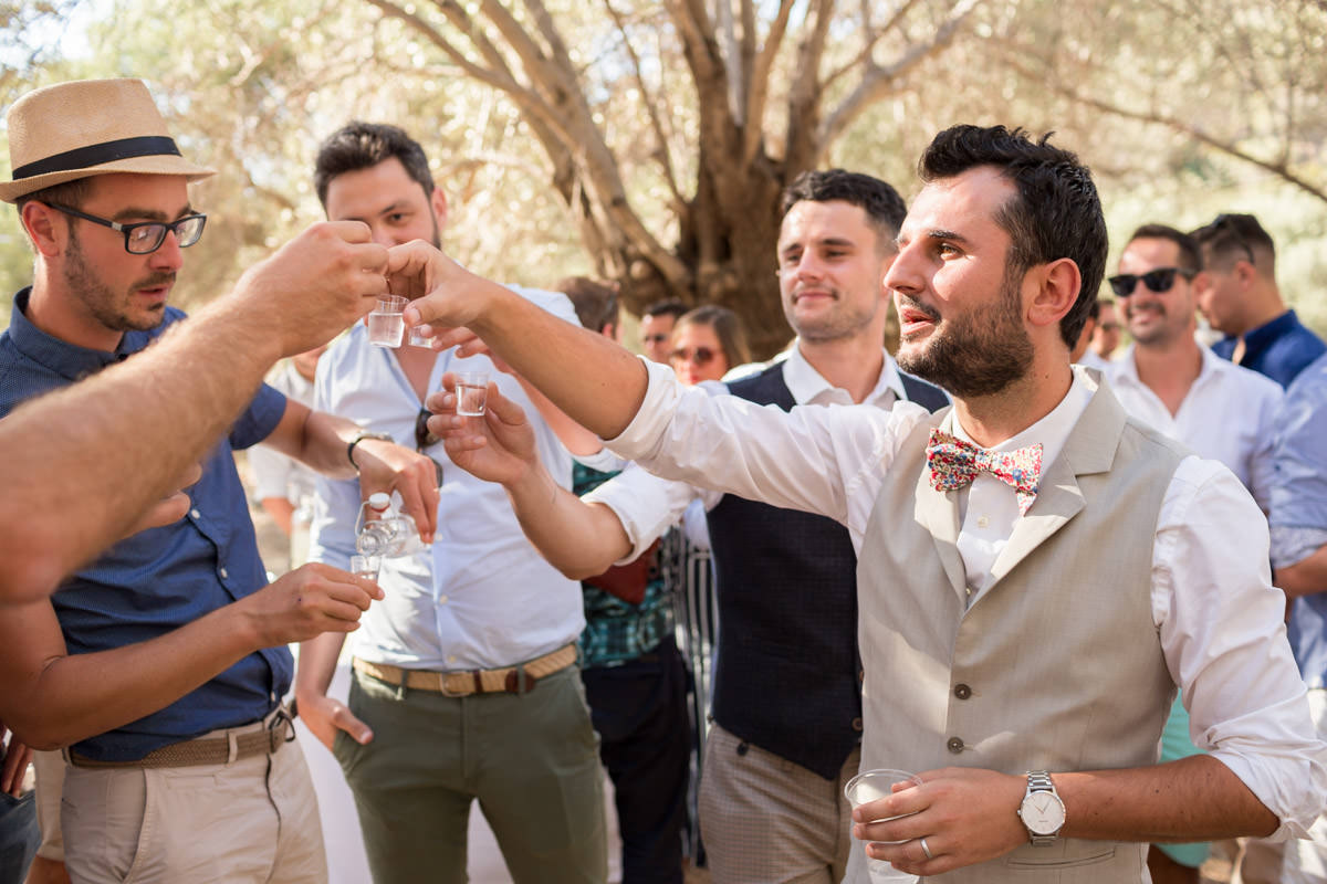 cheerful wedding in Crete drinking raki