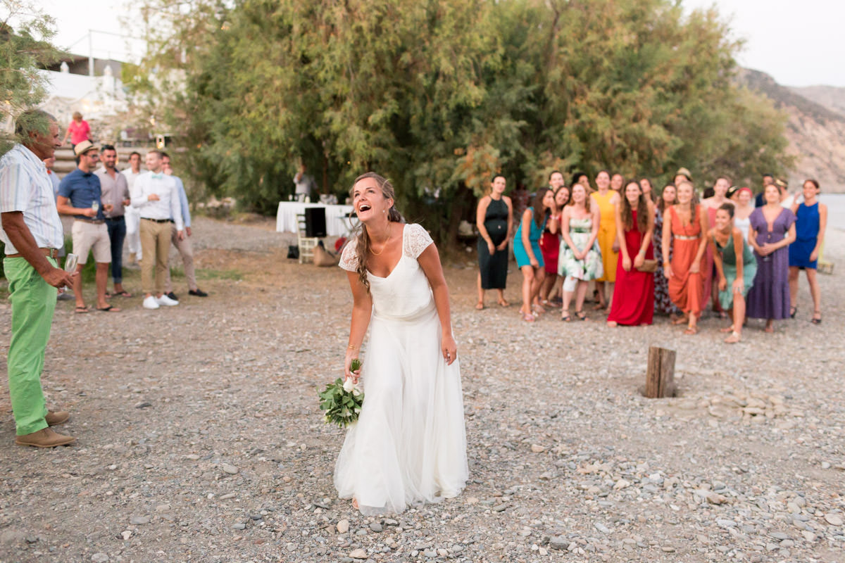 bride throws the bouquet in Crete