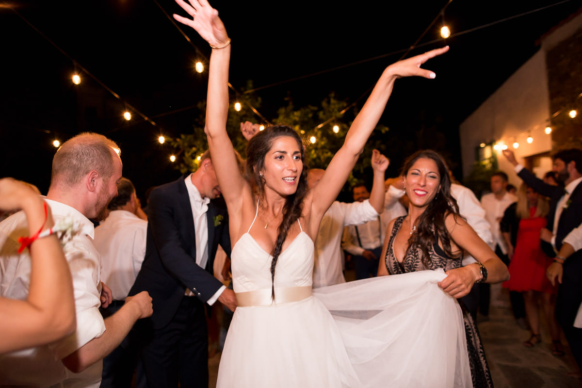 wedding party in Greece - bride dancing